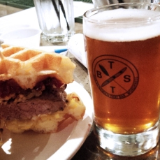 Bestie - Sausage & Pork Belly Waffle Breakfast Sandwich paired with Central City Red Racer Copper Ale infused with Maple.
